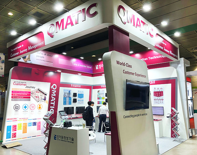 World trade show Qmatic and E1 information Technology