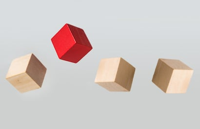 one red block and three wood blocks supended in air