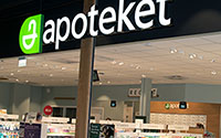 Overview of Apotekets store entrance with big sign