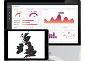 Datorskärm med statistisk skärmvy och surfplatta med karta