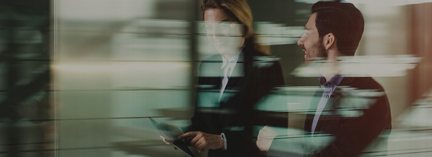 Blurred image of business man and woman talking
