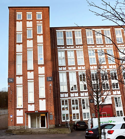 Qmatic Headquarters, red brick building and blue sky