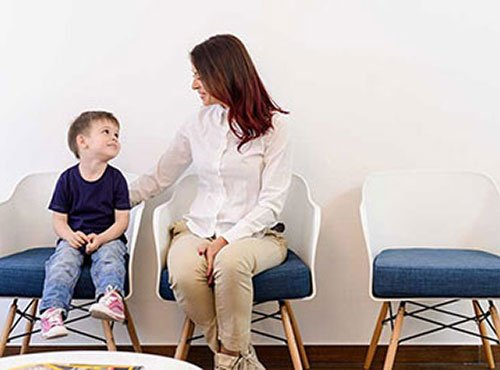 Woman and child sitting in waiting room